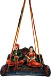 Enchanting Village Couple in Cushion Swing